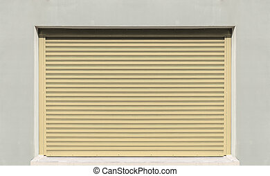 Shutter door or rolling door, beige color.