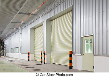 shutter door - Shutter door outside factory, night time.