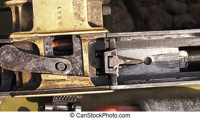 Shutter. Striking mechanism. The machine gun. The first...