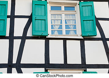 Shuttered window in a German timber frame house