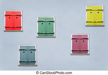 Shutters - closed windows with colorful shutters in the blue...