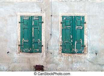 Shutters - locked shutters on an old house