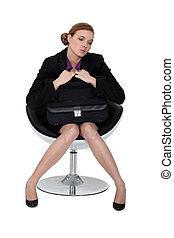 Shy applicant waiting on an armchair