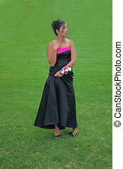 Shy Beauty - Beautiful young woman stands shyly in her prom...