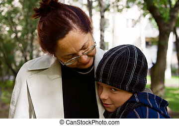 Shy Boy and his Grandmother - a young boy - grandchild, and...