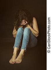 Shy girl in the corner cry