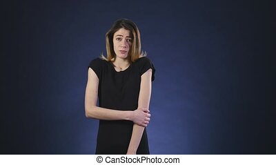 shy girl on dark background.