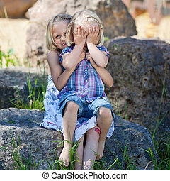 Shy little girl covering her face