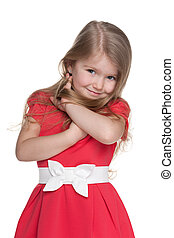 Shy little girl in the red dress