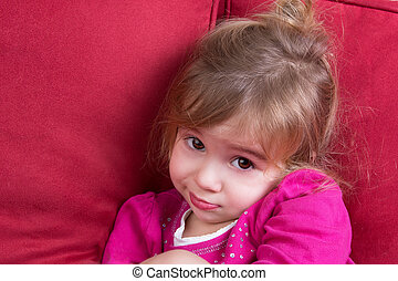 Shy little girl looking at the camera