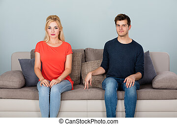 Shy Man Flirting With Woman At Home