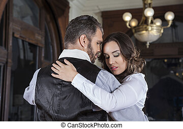 Shy Woman Performing Tango With Man - Shy young woman...