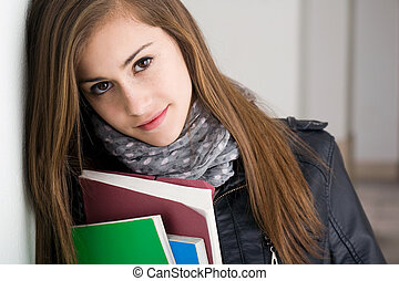 Shy young brunette student girl. - Closeup portrait of a shy...