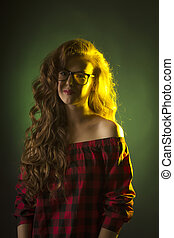 Shy young woman with long hair wearing glasses