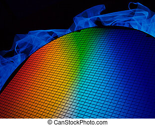 SI wafer - detail of a silicon chip wafer reflecting ...