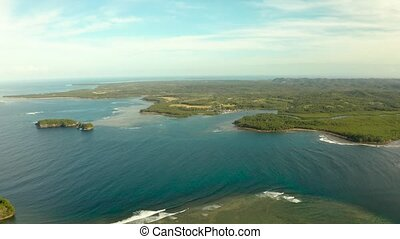 Siargao island and ocean, aerial view. - Seascape with the...