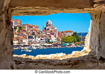 Sibenik waterfront through stone window view, Dalmatia, ...