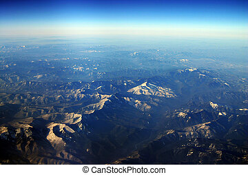 Siberia aerial - aerial photo of the frozen mountains in...