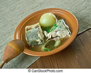 Siberian fish soup of omul (Coregonus autumnalis).