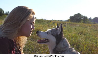 Siberian husky licking female owner and girl screwed up face...
