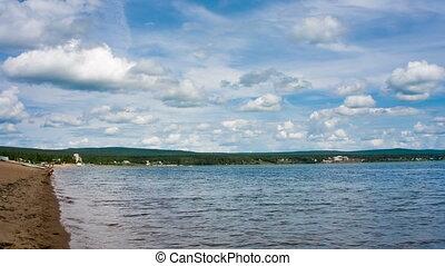 Siberian lake shoreline timelapse with waves. Shot in RAW, wide dynamic range