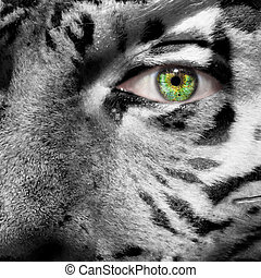 Siberian Tiger face superimposed on a human face with a green eye to create awareness for this endangered species
