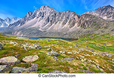 Siberian Tundra in highlands at peak of lake. Eastern Sayan...
