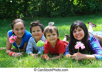 Sibling brothers and sisters - Four siblings consisting of...