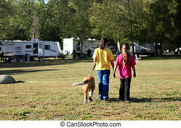 Girls Walking a Dog While Camping - Sibling Girls Walking a...