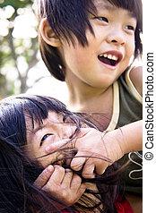 Sibling playing - Asian Sibling, brother and sister playing ...