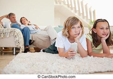 Siblings bored by tv program