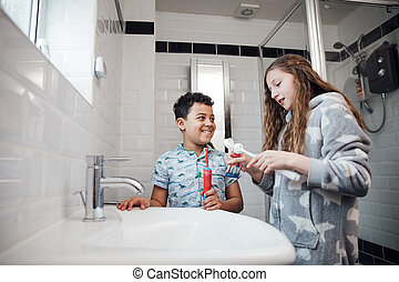 Siblings Brushing Their Teeth