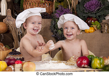 Siblings cooking in chef's hats - Siblings cooking, chef's ...