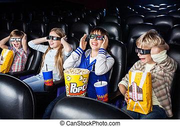 Siblings Enjoying 3D Movie In Theater