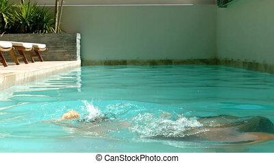 Siblings having fun in the swimming
