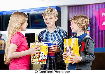 Siblings Holding Snacks At Cinema