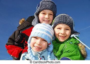 Siblings in winter - Three caucasian white kids in warm ...