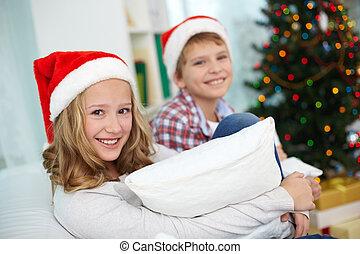 Siblings on Christmas - Portrait of happy girl looking at...