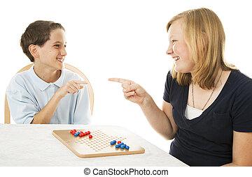 Siblings Play Games - Brother and sister having fun playing ...