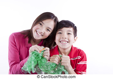 Siblings popping bubble wrap. - A brother and sister getting...