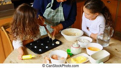 Siblings preparing cookie with grandmother in kitchen 4k