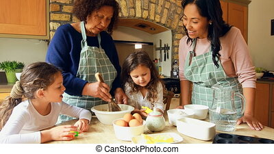 Siblings preparing food with family in kitchen 4k