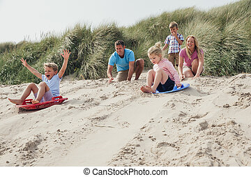 Siblings Racing Down the Sand Dunes