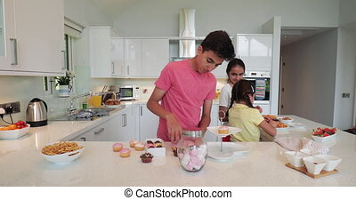 Siblings Sorting in the Kitchen - Siblings preparing and...