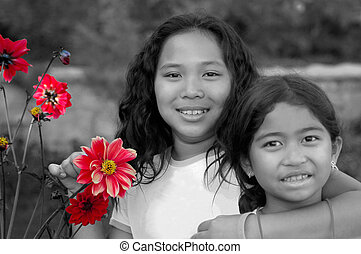 Siblings - Two young girls in the garden