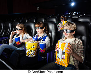 Siblings Watching 3D Movie In Theater