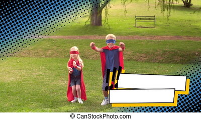 Siblings wearing superhero costumes at a park