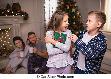siblings with christmas gift