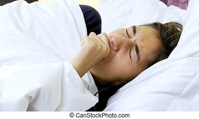 Sic woman coughing in bed - Woman with flu having bad time...
