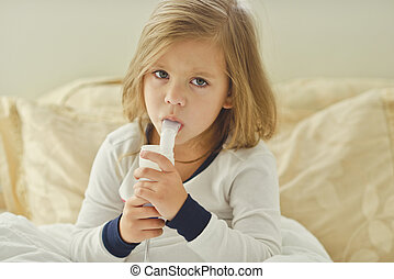 sich child - little girl with cough using inhaler at home
